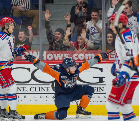 Flint Firebirds' Jake Durham, center, celebrates his goal against the Kitchener Rangers Saturday, Feb. 4, 2017, at the Dort Federal Credit Union Event Center in Flint, Mich.