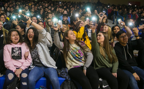 Eisenhower High School students raise their mobile flashlights during a Martin Luther King Jr. Assembly at 611 S. 44th Ave. in Yakima, Wash. on Friday, Jan. 18, 2019. Forty one chairs were placed on the gymnasium floor symbolizing martyrs who took civil rights actions.
