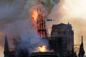 The cathedral's spire collapsing.