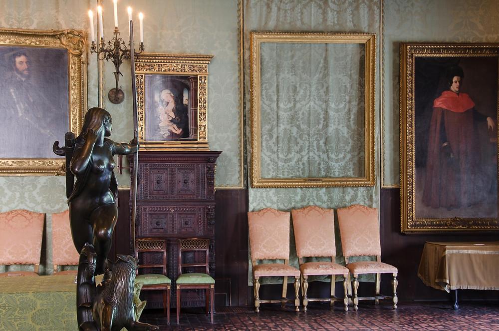 An empty frame hangs in the Isabella Stewart Gardner Museum in Boston, MA
