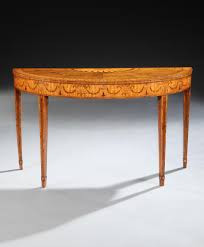 Figure 3: Attributed to William Moore, Pair of 'George III' Marquetry Pier Tables, circa 1775, sycamore, stained wood, and marquetry © Christie's Auction
