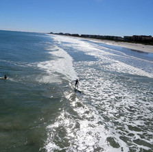 Surfers from Cocoa Beach Pier