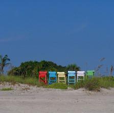 Cocoa Beach beach chairs on dune