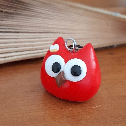 Grigri chouette rouge