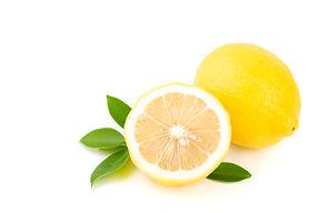 Yellow Lemon citrus half slices with lea