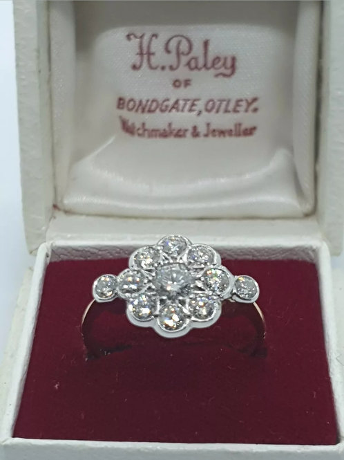 18ct and platinum art deco style diamond daisy cluster ring