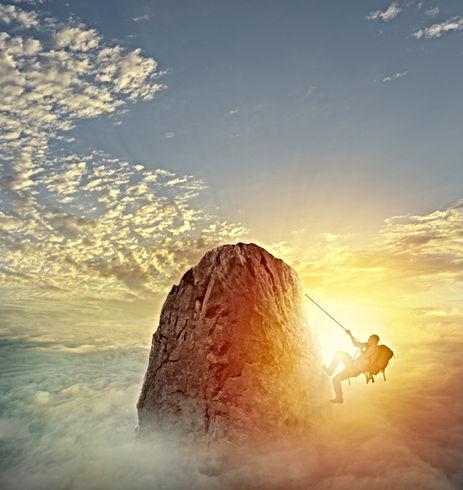 Businessman climb a mountain to get the
