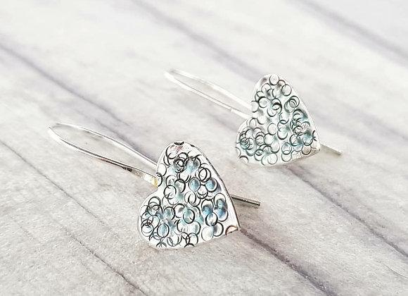 Fixed wire heart drop earrings.
