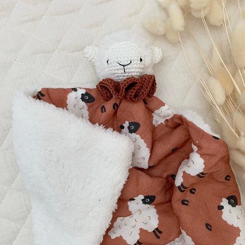 Doudou mouton rouille