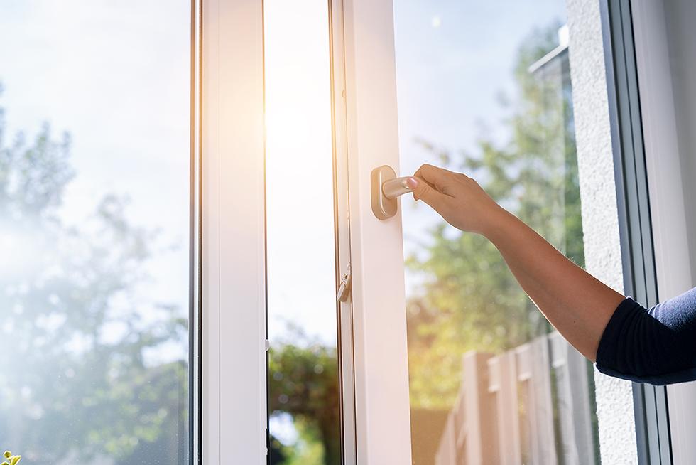 Female hand opening doubled glazing window
