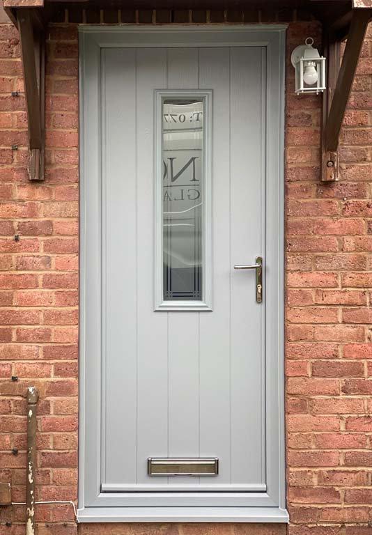 Main entance door in grey