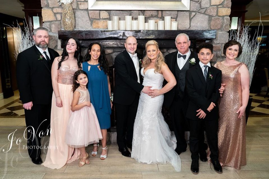 Jessica with her siblings, her Dad and stepmom, and brother-in-law
