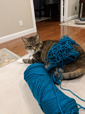 Jessica trying to crochet