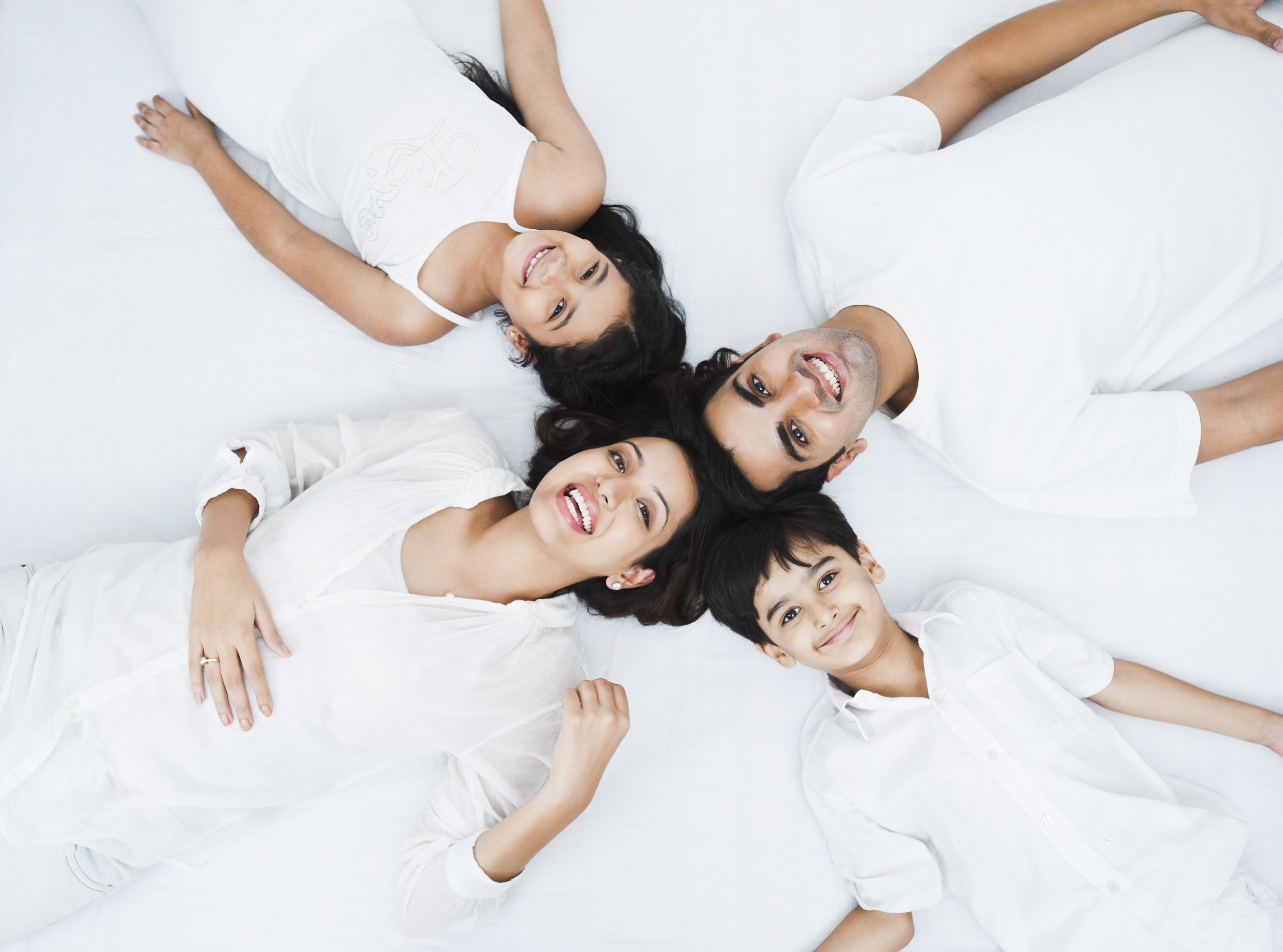 High angle view of a happy family lying