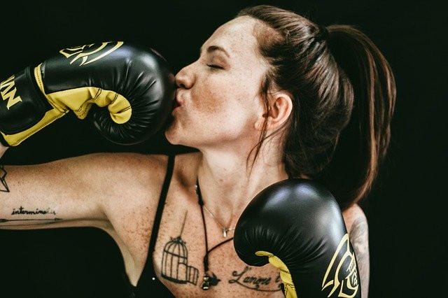 Woman kissing boxing glove