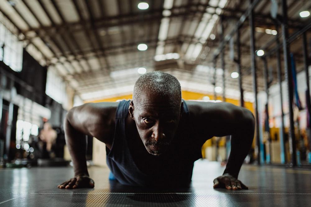 Man Doing Pushups In Gym
