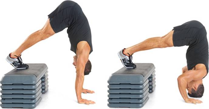 Man doing modified handstand pushup