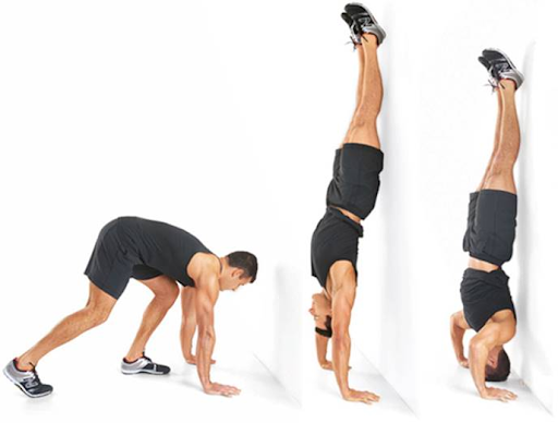 Man progressing to handstand against a wall