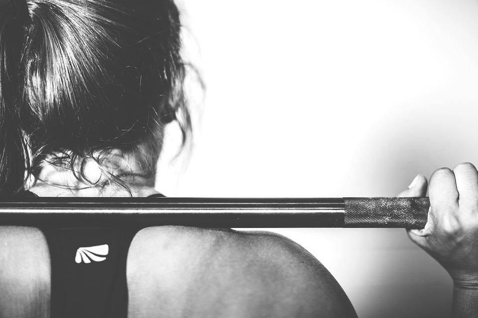 woman squatting skinny to buff