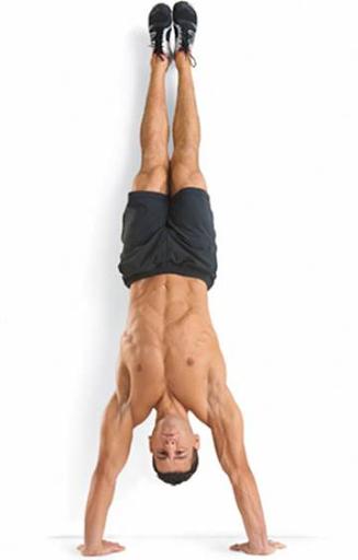 Man doing handstand pushup