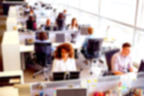 Workers in open office environment