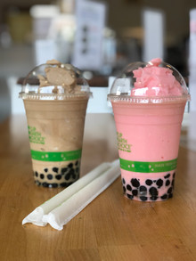 Milk tea and strawberry ice-blended boba