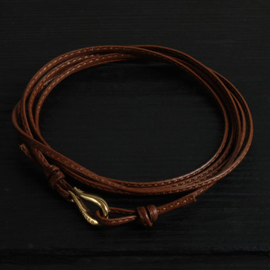 "Fine brown leather cord bracelet and ""hook"" Orner clasp in vermeil"