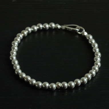 """Hook"" clasp and silver beads"