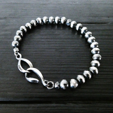 """Infinit"" clasp and oxidised silver beads"