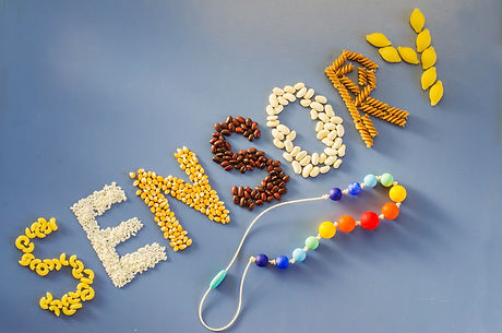 Sensory word written of rice, popcorn, beans, pasta. Sensory play for child at home. Activ