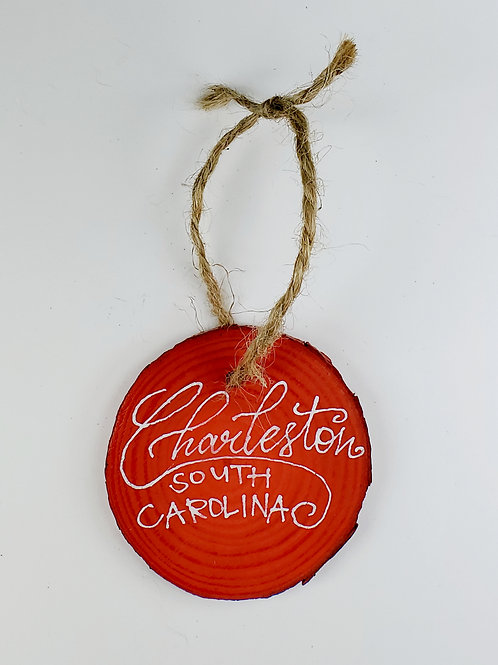 White Lettering on Red Wooden Ornament