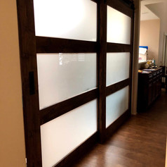 bypasing ceiling mounted glass doors