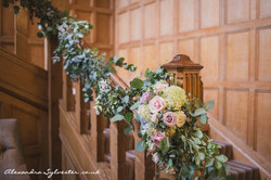 Stairway flowers, bannister, roses and eucalyptus