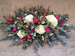 Funeral flowers roses hydrangeas ranunculus