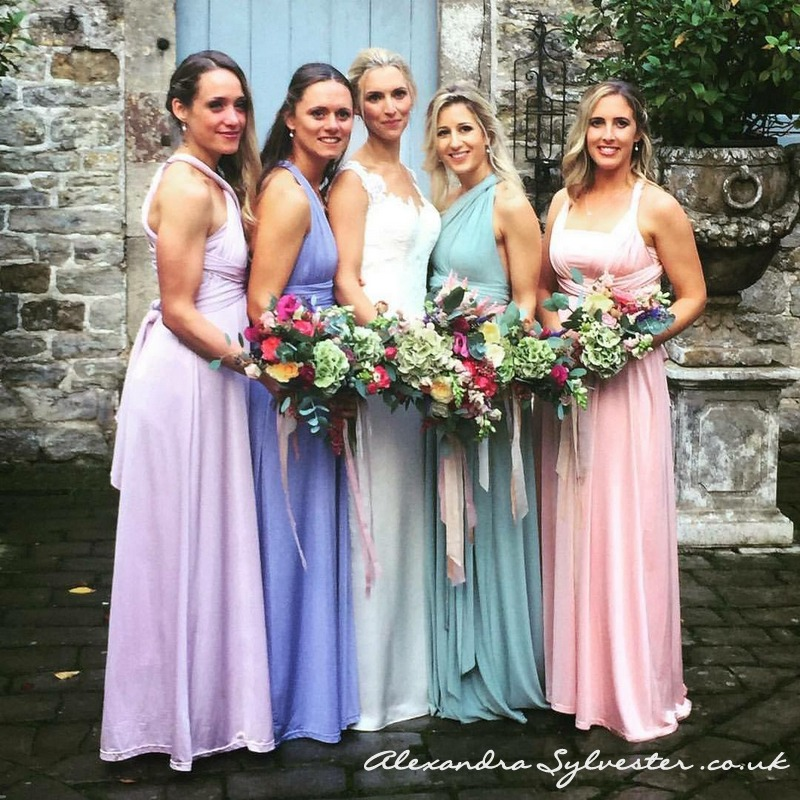 Bride and pastel bridesmaids