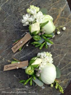 White ranunculus buttonholes