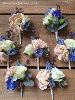 Peach and blue buttonholes