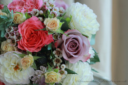Dahlias, roses and wax flower
