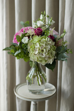 Hydrangea and rose vase