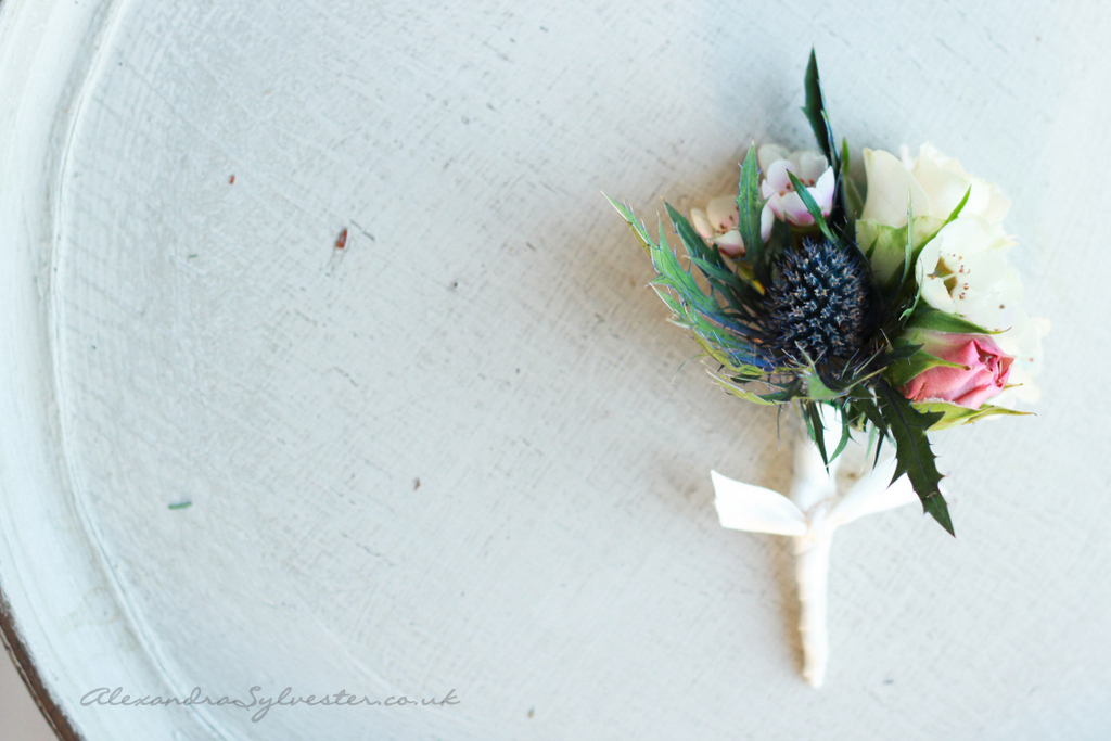 Rose, wax and thistle buttonhole