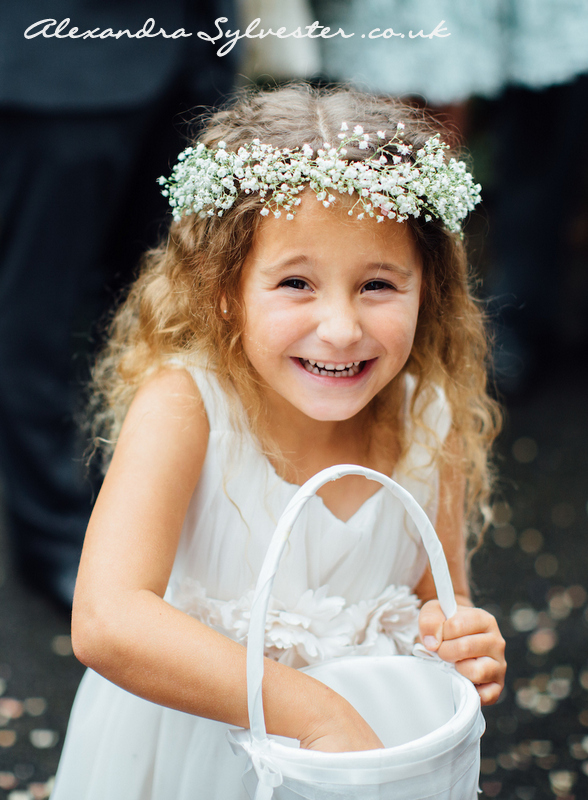 Little flower girl with gypsophila crown