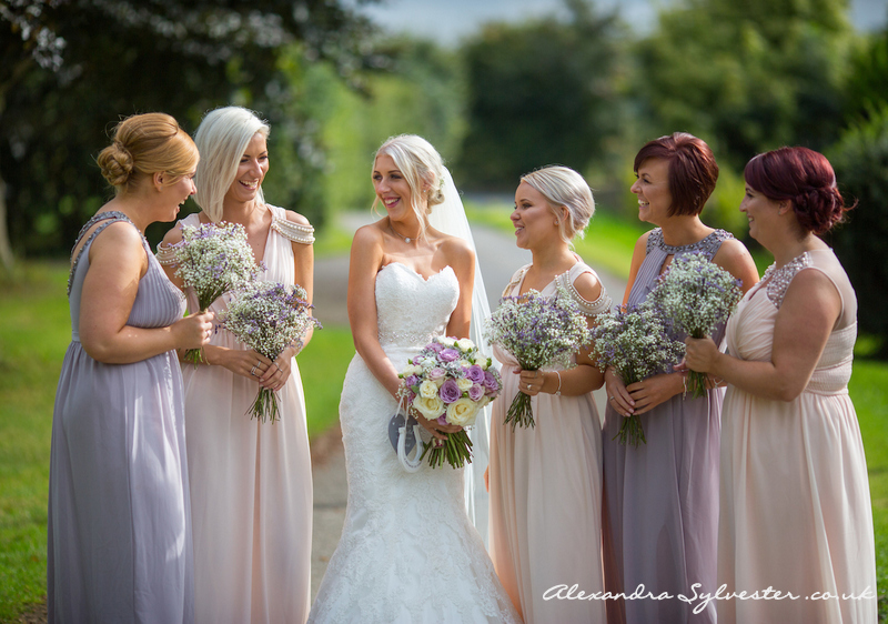 Beautiful bride and her bridesmaids in shades of lilac