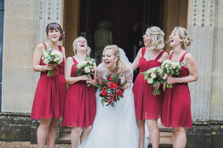 Red rose and pine cone bouquet