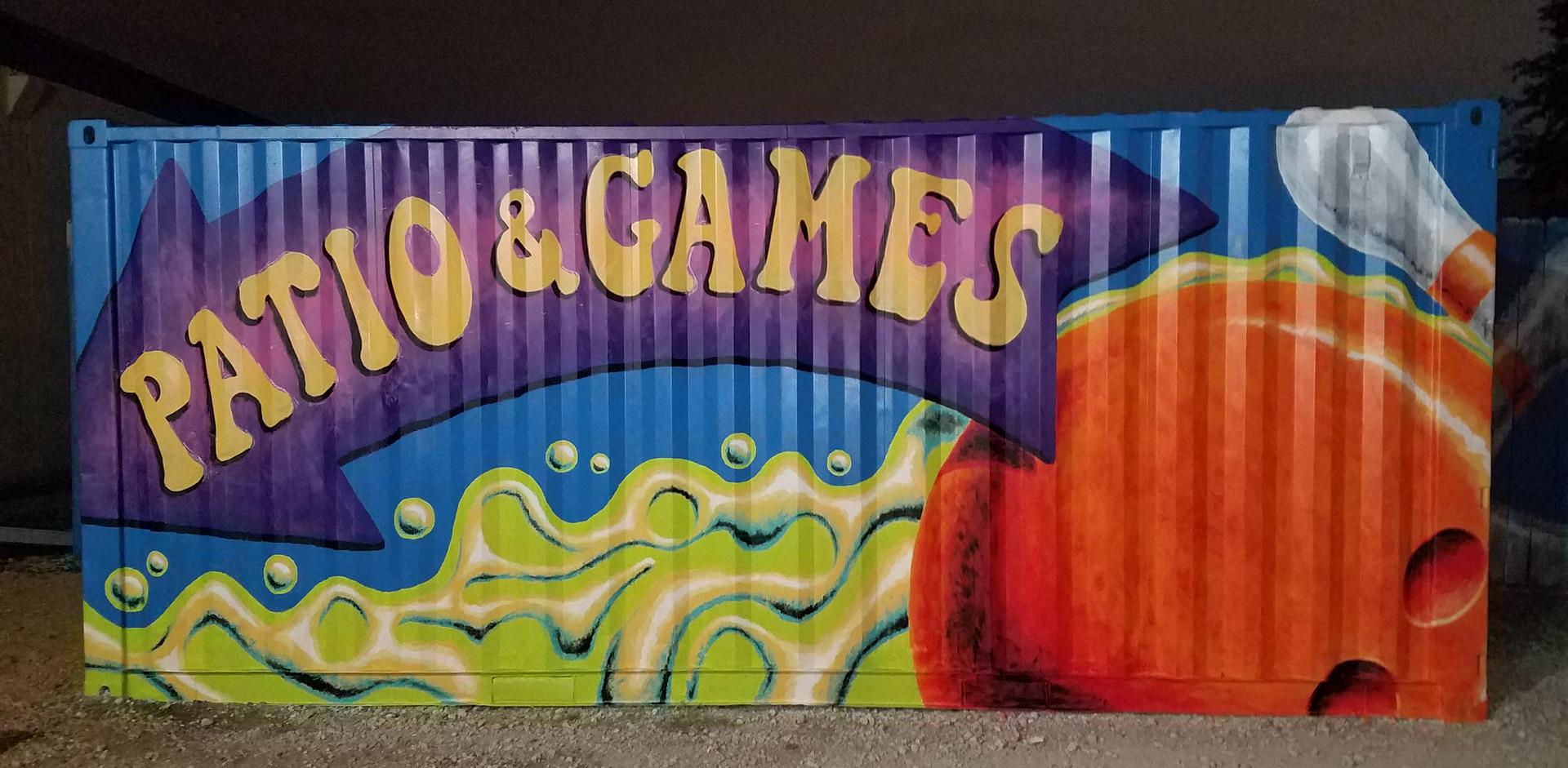 <--- PATIO & GAMES