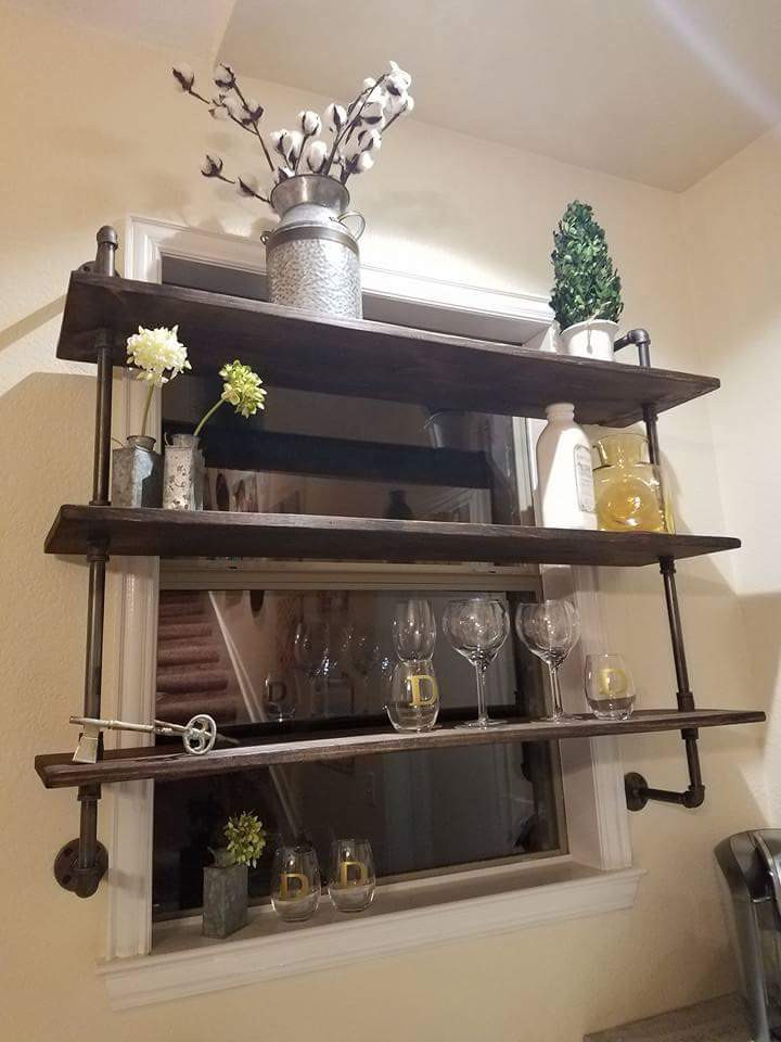 Industrial design...iron pipe & wood shelves