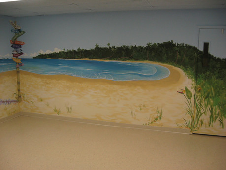 ocean inlet and foliage painted wround the wall and over the entry door -