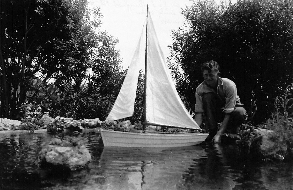 "Late 1930s Bob Bradshaw, aged about 17-years, in the late 1930s with sail boat he won, testing its seaworthiness on the pond at Springfield Rd, Haumoana.  Bob, who won the prize for developing ""a lovely garden"", lost his life in WW2."