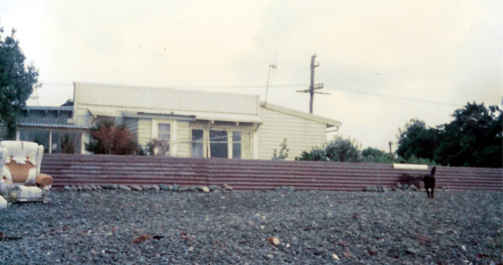 9 Clifton Road, Haumoana, with corrugated iron fence sea defence