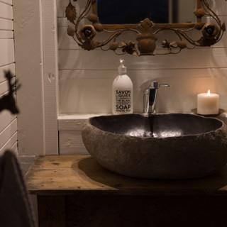 Bathroom with polished stone basin - Kowhai Retreat