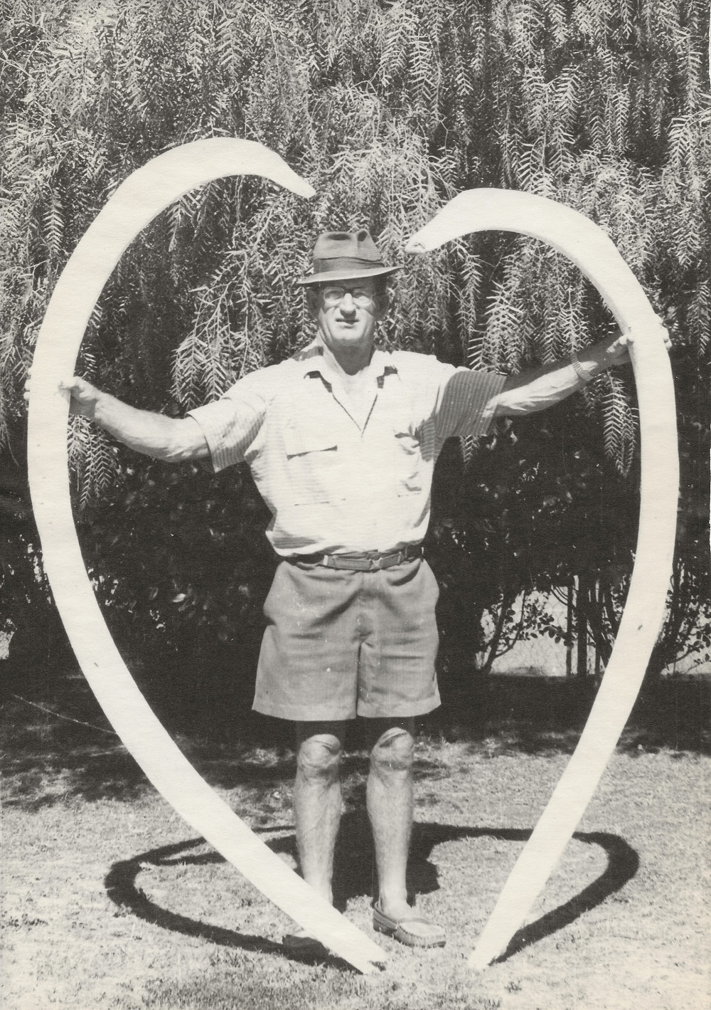 Neil Burden standing tall with two of the recovered whale bones forming a heart shape